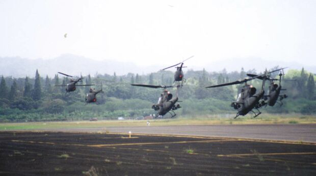 Image: Three OH-58A/Cs and three AH-1Fs take off from Wheeler Army Airfield